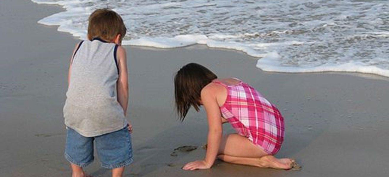 Kids enjoying summer on the beach